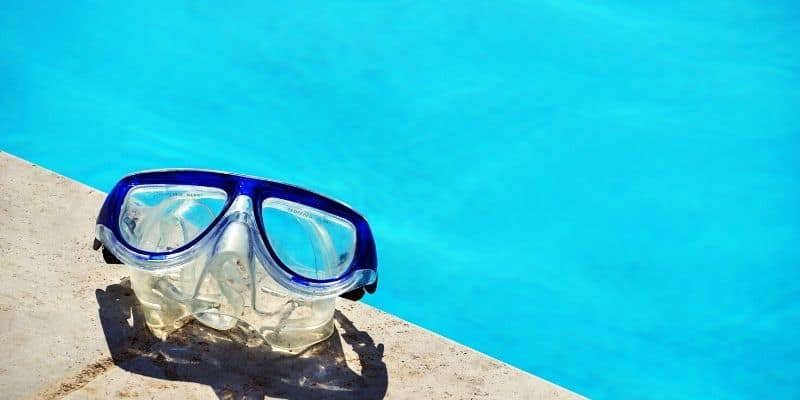 snorkel mask by a swimming pool