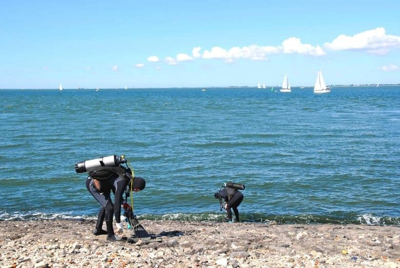 scuba boots protection on rocky beach